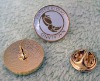 Brass school badges (the surface is covered by epoxy resin)