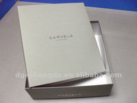 White square cardboard boxes with silver stamping