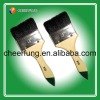 Paint brush with black bristle and wooden handle and green tip