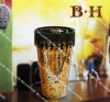 glass cylinder with a tea light holder
