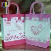 Pink and white pretty handmade paper gift bag with romantic heart