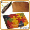 Italian leather change purse with puzzle pattern