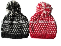 Knitted beanie hat with top ball