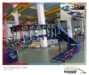 Unloading conveyor system for trucks, vans, containers