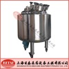 Bottom magnetic material mixing tank
