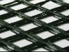 Self-adhesive fiberglass geogrid with asphlt reinforcement for road construction