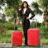 red color hard shell luggage trolley case