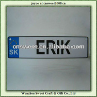 white aluminum embossed logo metal license plate