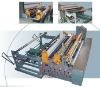 Automatic nonwoven pneumatic slitting and rewinding machine