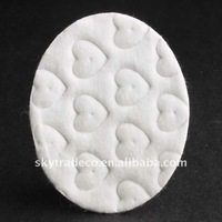 Cosmetic cotton pads in oval shape with embossed surface