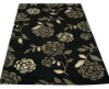 Black tufted rug