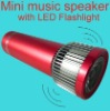 Full-function led tech light flashlight with fm radio and music speaker
