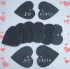 Blackboard marker in heart shape by natural slate