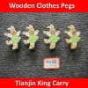 brown rabbit wooden clothes hanging pegs