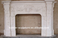 white marble pillar style fireplace mantel